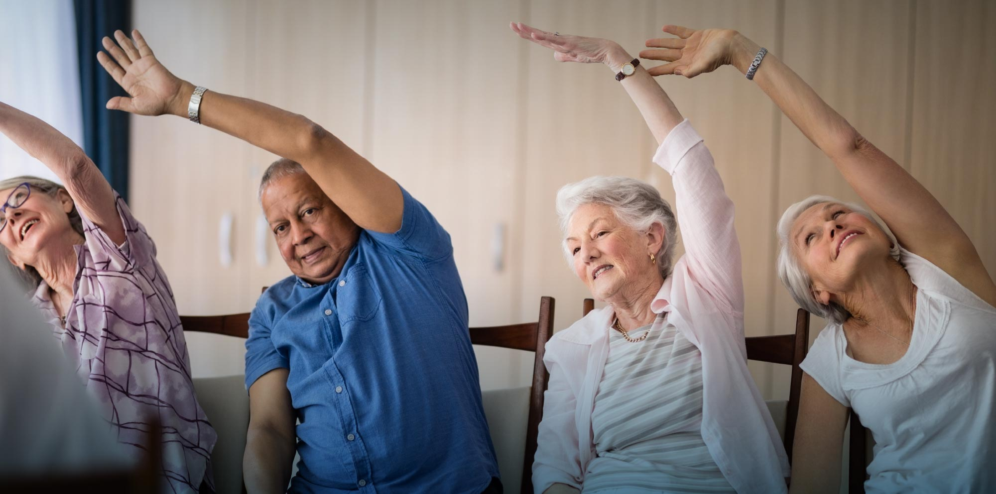 Senior citizens working out sitting down