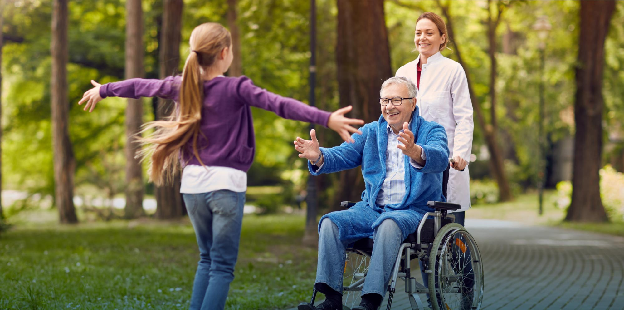 Hugging grandpa in a wheelchair
