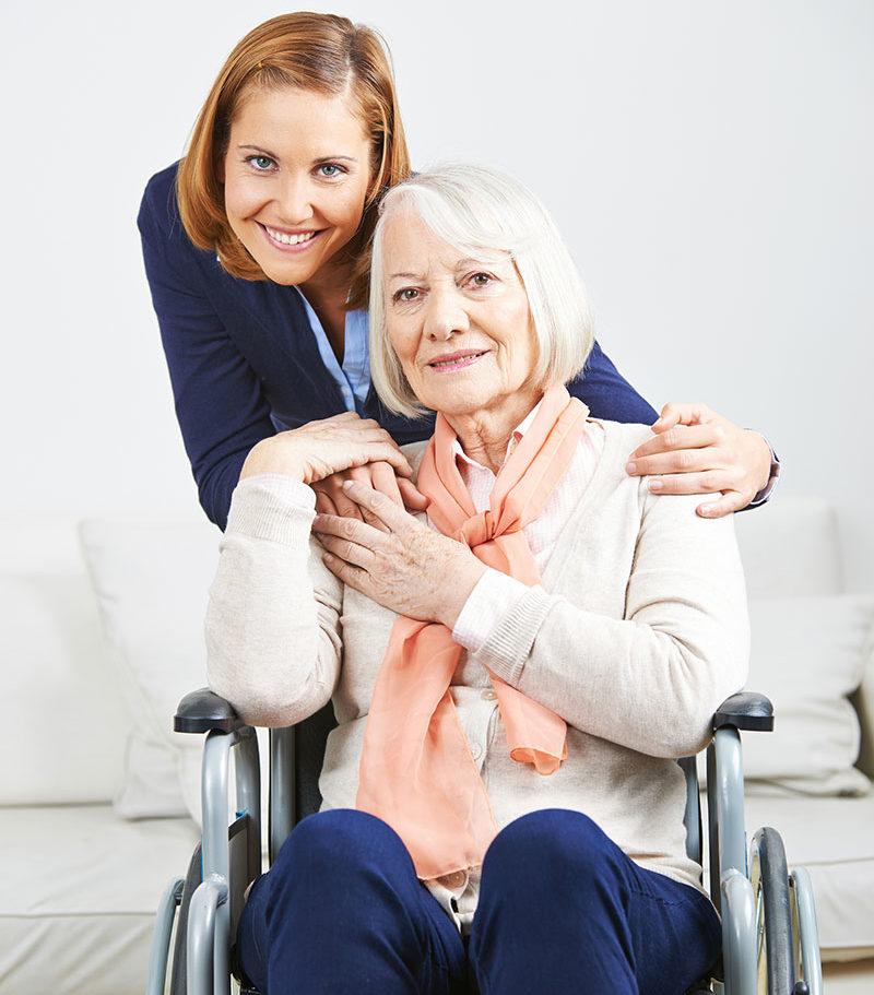 Daughter hugging senior mother