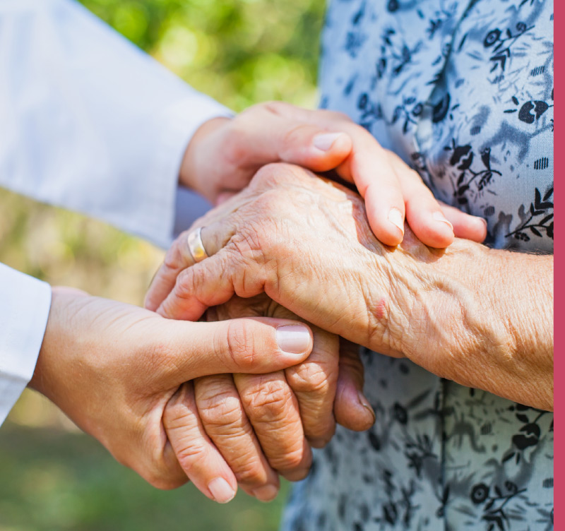 Comforting a senior patient with a gentle touch.