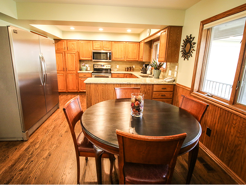 Dining area photo with kitchen in background